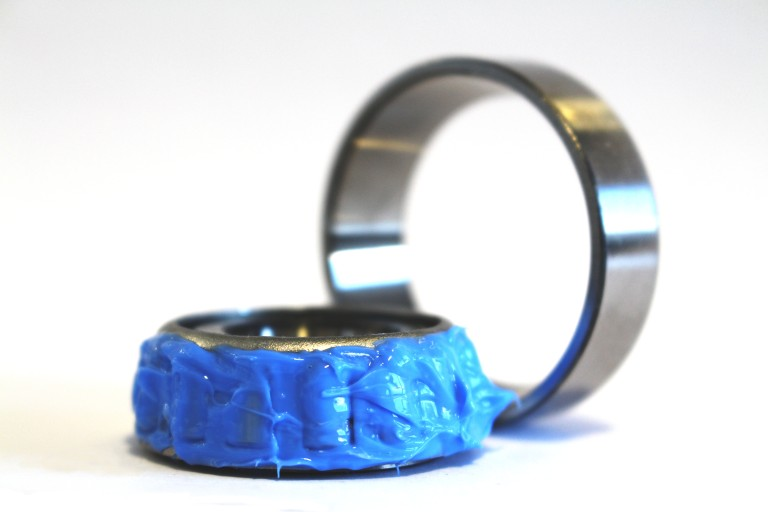 A rolling bearing lubricated with PFPE grease
