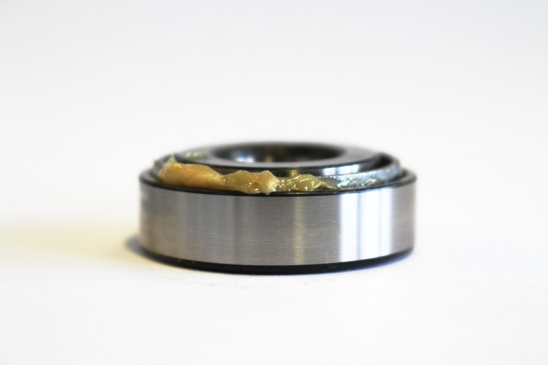 A rolling bearing lubricated with calcium complex soap grease