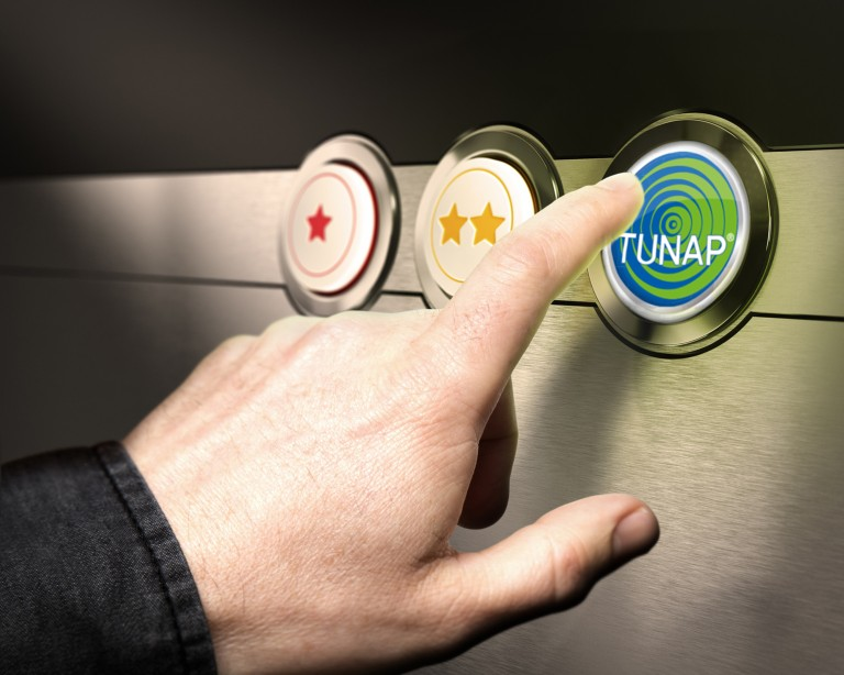 Hand pointing at a button with TUNAP writing